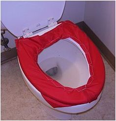Toilet seat cover made of rip-stop nylon for sliding transfers - keeps the skin from sticking.  Outreach Therapy Consultants