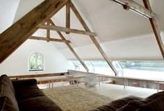 House G by Maxwan | Photo © Filip Dujardin wood beams modern interior - living room http://www.woodz.co/house-g-transformed-old-barn/