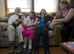 Tom Funkhouser and his wife, Patti, at right, have two daughters: Lori, 24, second from left, and Jessica, 28, who were born with a rare genetic disorder causing developmental disabilities. Lori requires 24-hour care, while Jessica has a job.