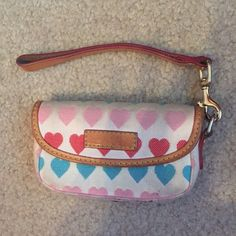 Dooney & Bourke Wristlet Could hold a camera or could be used as a wallet. Not in new condition but is still in good condition. Heart design. Dooney & Bourke Bags Clutches & Wristlets