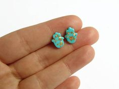 Teal green and gold flakes evil eye hamsa stud earrings made with polymer clay
