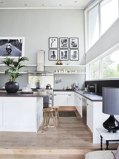 Kitchen. Bright. White and Black. Wood Floor. Art. Windows. Plants. Decor. Interior Design. Home. Island. modern.