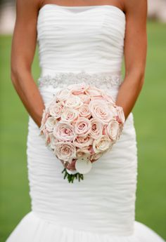 this classic and timeless rose bouquet creates a very clean and stunning look. see more beautiful work from Lemiga Events here http://www.weddingchicks.com/vendor-guide/lemiga-events/