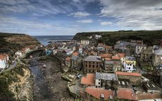 """Staithes, North Yorkshire The county's greatest hidden gem, according to Joe Shute, our Yorkshire expert. """"The beautiful village - once the home of Captain James Cook - is nestled in a steep tiny cove rich with fishing and artistic history. James Cook, English Villages, Places To Travel, Places To See, Travel Stuff, Sea Angling, Tours Of England, Fishing Villages, English Countryside"""