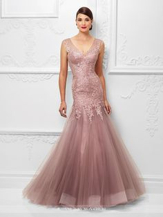 Tulle and lace trumpet gown with lace trimmed illusion slight cap sleeves, front and back illusion V-necklines, sweetheart dropped waist lace bodice, horsehair hemline. Matching shawl included. Sizes: 4 – 20, 16W – 26W Colors: Pink Topaz, Bronze
