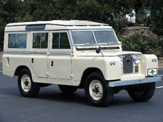 1963 Land Rover Series IIA 109 Station Wagon. Mine was green though. I paid $2500 for it, drove it forever, but putting in a new engine was out of the question, I thought. Wish I had done it. I miss this car.