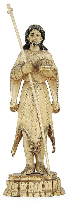 An Indo-Portuguese ivory figure of Saint John the Baptist, Goa, 17th or 18th century. HAUT. 14,3 cm HEIGHT. 5 5/8 IN.