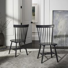 with its spindle openwork back and charcoal grey finish this malaysian oak side chair