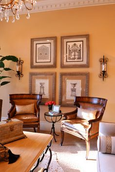 These fine carved and ash burl club or occasional chairs feature curved toprails above scrolling arms, on hand carved sabre legs. The designs are taken from the Regency period and have a quintessentially English look and feel.   Seen here in a traditional living room by Houston Architect and Designer Cindy Aplanalp at By Design Interiors.