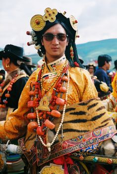Litang Horse Festival, Eastern Tibet, 2007 or earlier {nice to see some detail of men's jewellery }