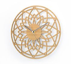 This bamboo wall clock is called Complex Star. The delicate design of this clock makes it a unique timepiece that looks great in a modern or traditional home and its natural colour fits well with any colour scheme.  The clock face is laser cut from eco friendly solid bamboo. Outside diameter of face is 280 mm (11).  The clock mechanism is a quartz sweep type which means its virtually silent, no ticking, and has black hands. Comes complete with integral fixing bracket so it`s ready to ha...
