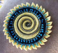 Zipper swirl felt brooch by woolly  fabulous, via Flickr