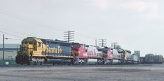 https://flic.kr/p/YLF4Td | Santa Fe Action in Fresno. CA -- 4 Photos | The power consist was ATSF 5334, 889, 834, and 5853 on March 7, 1994. The units were a SD45u, C40-8W, C40-8W, and SD45-2u elephant style.