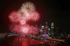 Fireworks explode in Marina Bay against the skyline of Singapore during New Year's Day celebrations January 1, 2016.