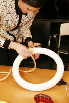 Step 1 of @Natalie Jost Soud | A Dose of the Delightful Jingle Bell Wreath: Wrap wreath with rope, securing with hot glue. #pinspirationparty