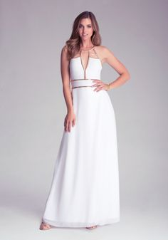 This bebe maxi dress with embellished waistline and geometric halter straps is all glamour and no fuss. Featuring a high front slit, wrapped chiffon skirt and invisible zipper, this dress requires a pair of a teardrop rhinestone earrings and a strappy heel for an event-ready outfit that will make you the talk of the town.