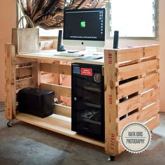 Modern pallet desk on wheels. I like how it holds the computer underneath.