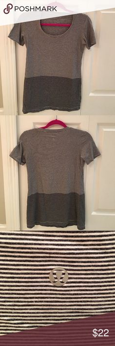 Lululemon Tee Loose Fit Scoopneck Excellent used condition, supersoft scoopneck tee. Tear tag has been removed. I think that the shirt is a size 6. I wear a size 8 jacket at Lululemon and this is a bit tight. No visible signs of wear, no pilling or pulls lululemon athletica Tops Tees - Short Sleeve