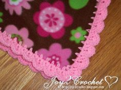 Fleece Baby Blankets with Crocheted Edge...also has a link where to buy the skip stitch blade to punch the holes along the edge.