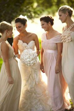 Love her gown, her flowers, and the idea of white bridesmaids dresses!