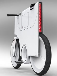 EBIQ battery powered bike for short distance metro commuting,  built in screen provides direct access to laptop and cell phone, while charging devices.