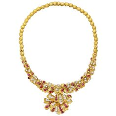 Van Cleef & Arpels Ruby Diamond Gold Foliate Link Necklace | From a unique collection of vintage link necklaces at http://www.1stdibs.com/jewelry/necklaces/link-necklaces/