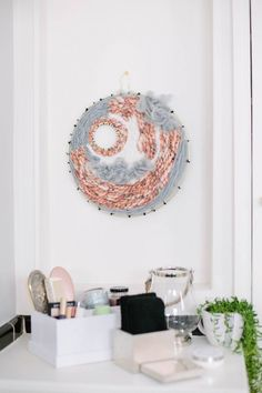DIY Beauty Oasis Bathroom Makeover | Woven tapestry to tie in the key colors