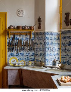 http://l7.alamy.com/zooms/900e9d8e474c4c51a94f570d99c52add/delft-tiling-in-kitchen-corner-with-marble-topped-work-surfaces-and-eww6gx.jpg