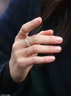 EXCLUSIVE: Meghan Markle has set tongues wagging once again after sporting an unusual arrangement of rings on her middle, index and fourth fingers during a visit to Edinburgh.