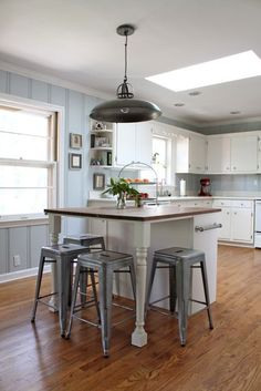 Kitchen: DIY butcher block island, Woodlawn Sterling Blue paint, industrial CB2 pendant light, original white cabinets, tolix style stools