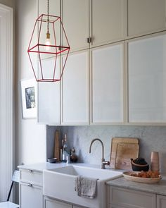 Cool Decorating Trick No. 39 | Ribbon Wrapped Pendant from Martha Stewart Living.  Two lamp frames wrapped together, so simple, yet brilliant!