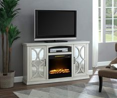 White Mirror Door Console Electric Fireplace at Big Lots. Big Lots Fireplace, Tv Console With Fireplace, Electric Fireplace Tv Stand, Fireplace Mirror, Faux Fireplace, Electric Fireplaces, Mirror Tv Stand, White Tv Stands, Tv Display