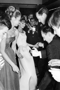 Audrey Hepburn and Mel Ferrer dancing with other people at the Annual Children's Hospital Benefit Charity Ball, France, January 14, 1962.