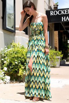 """Citrus+hues+create+a+bold+chevron+pattern+along+this+strapless+dress+finished+with+a+waist+detail.++Style+with+sandals+&+a+long+necklace+for+an+effortless+summer+look.++++<br><br>++  -52""""+length+from+shoulder+to+hem+<br>  -33""""+chest<br>  -28""""+waist<br>  -37""""+sweep<br>  -Measured+from+a+size+small<br><br>  -100%+Polyester+<br>  -Dry+Clean+Only+<br>  -Imported+<br>"""