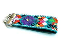 Beautiful floral keychain that makes the perfect gift for anyone that appreciates the beauty in ethnic cultures. These wrist key fobs are designed with bold, colors, patterns and texture. A beautiful accessory to compliment a unique style. The bright, colorful floral patterns makes your keys easy to spot, so you will never lose your keys again! The functions for these are endless. Use them to add style to your purses and totes, wear them like a bracelet to keep your keys accessible while…