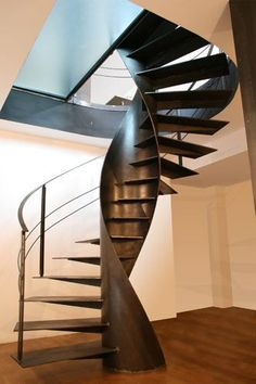 Art becomes functional with this stunning architectural staircase design. Created by Italian company Sandrini Scale, the Etika metal spiral staircase is sculptural, beautiful and practical all at once. The helix-shaped metal structure is formed by blending two spirals; one outside and one inside serving as a rigid support for the former.