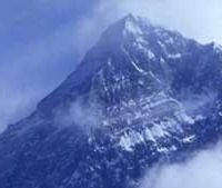 Mount Everest is the highest mountain in the world with the summit reaching a peak of 29,029 feet (8,848 m). It is located in the Himalayan mountain range on the border between Nepal and Tibet, China.
