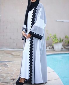 We are going to introduced with you a new style of abaya designs 2018 & gown fashion for women. New Styles of abaya designs and gowns were recently launched by famous fashion Hijab Fashion 2017, Abaya Fashion, Fashion Outfits, Womens Fashion, Islamic Fashion, Muslim Fashion, Modest Fashion, Abaya Designs, Abaya Dubai