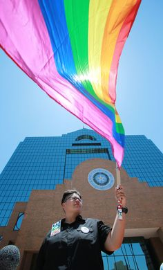 A woman celebrates the U.S. Supreme Court's decision to legalize same-sex marriage nationwide outside the El Paso County Courthouse on Friday in El Paso, Texas. | AP