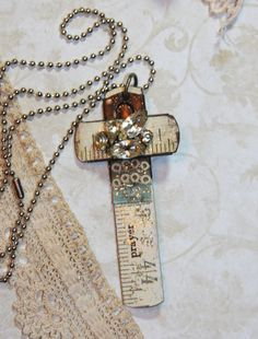 BLUE & Rhinestones Carpenters Cross Vintage Ruler Necklace. $19,99, via Etsy.