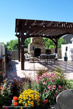 Solid wood timber framed pergola finished with a Rich Cordoba stain, fireplace and outdoor furniture.
