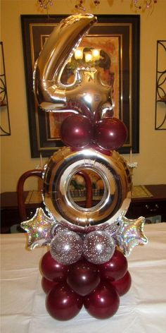 Elegant balloon centerpiece in gold, burgundy and silver. Great decoration for a 40th birthday or anniversary.