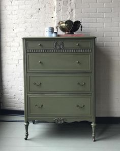 Rich and classic dresser painted with Chalk Paint® in Olive and protected with Clear Chalk Paint® Wax | Knobs accented with Annie Sloan Gilding Wax in the color Warm Gold | Project by Annie Sloan Stockist Vintage Style and Designs of Louisville & New Albany, IN