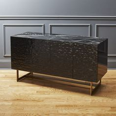 Shop ripple media console.   Dramatic black marquina marble reveals seriously chic style by designer Ceci Thompson.