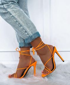 Description- Orange High Heels- Wrap Around Tie Style- Silver Toggle End Detailing- Straight Stiletto Heel- Heel Height: FabricationMan made upper, lining & sole. SizingTrue to Size Heels Outfits, Mode Outfits, Sandals Outfit, Fall Outfits, Pumps Heels, Stiletto Heels, Neon Heels, Tie Up Heels, Orange High Heels