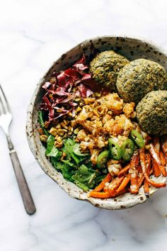 Keep your glow all winter! Easy homemade falafel, roasted veggies, and flavorful sauce all in one big bliss bowl! vegetarian / vegan / gluten free recipe. #vegetarian #vegan #glutenfree #healthy #saladrecipe #cleaneating | pinchofyum.com