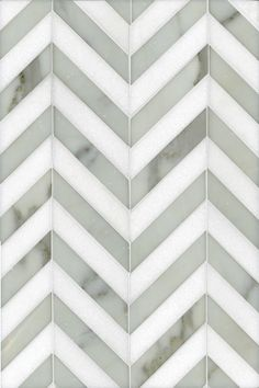 Maharajah Stripe by Studium, a chevron design in Calacatta Tia and Thassos. Beautiful for a kitchen backsplash.