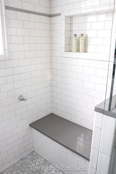 We chose shiny white subway tile with light gray grout for the walls, with an accent line of gray tile. We chose shiny white subway tile with light gray grout for the walls, with an accent line of gray tile. White Subway Tile Shower, Subway Tile Showers, Bathroom Showers, Bathrooms With Subway Tile, Tiled Showers, Gray Shower Tile, Glass Subway Tile, Beautiful Bathrooms, Modern Bathroom