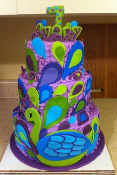 Cool! But of course add a zebra print layer:)  Peacock cake