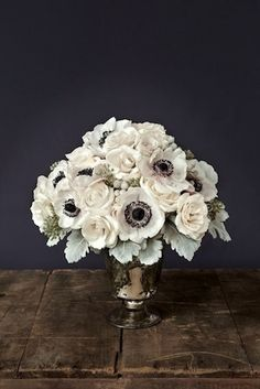 Gorgeous centerpiece! Love the colors, blooms, leaves, and vase.   Centerpiece of Majolica spray and Vendela roses, Tetra anemone, dusty miller, silver brunia and seeded eucalyptus in an antique-silver mercury vase